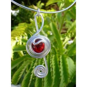 """Clave de sol"" pendant with small glass cabochon"